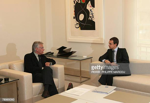 Spanish Prime Minister Jose Luis Rodriguez Zapatero talks with former Spanish premier Felipe Gonzalez on the steps of the Moncloa palace in Madrid 19...