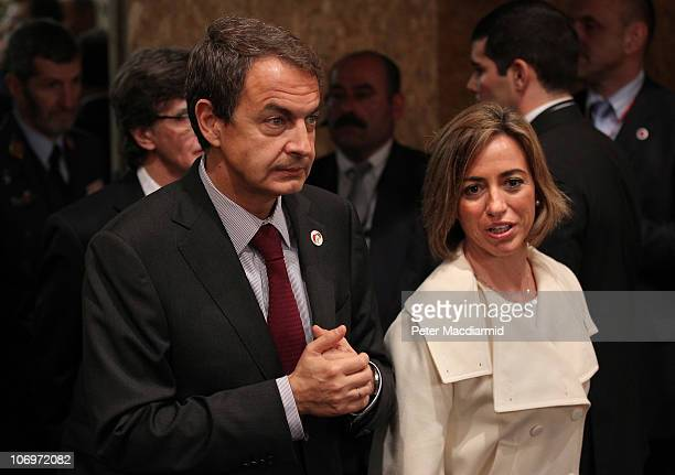 Spanish Prime Minister Jose Luis Rodriguez Zapatero walks into the North Atlantic Meeting with Spanish Defence Minister Carme Chacon Piqueras during...
