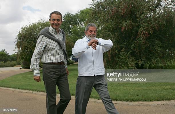Spanish Prime Minister Jose Luis Rodriguez Zapatero walks with Brazilian President Luiz Inacio Lula da Silva at the Quintos de Mora ranch near Toledo...