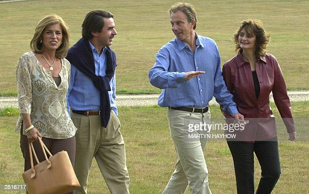 Spanish Prime Minister Jose Maria Aznar and his wife Anna Botella walk with his British counterpart Tony Blair and his wife Cherie after arriving at...