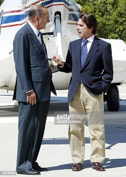 Spanish Prime Minister Jose Maria Aznar confers with French President Jacques Chirac before a meeting at Quintos de Mora in Toledo at south of Madrid...