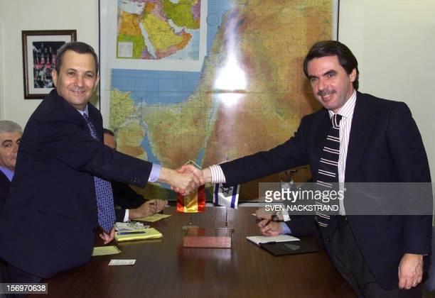 Spanish Prime Minister Jose Maria Aznar shakes hands with his Israeli counterpart Ehud Barak in Tel Aviv 23 December 1999 Aznar arrived earlier in...