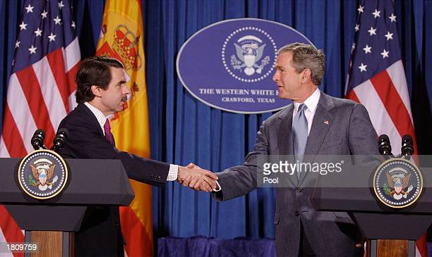 Spanish Prime Minister Jose Maria Aznar shakes hands with US President George W Bush after a joint press conference at Bush's ranch February 22 2003...