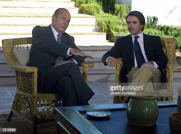 Spanish Prime Minister Jose Maria Aznar speaks with French President Jacques Chirac before a meeting at Quintos de Mora in Toledo south of Madrid 11...