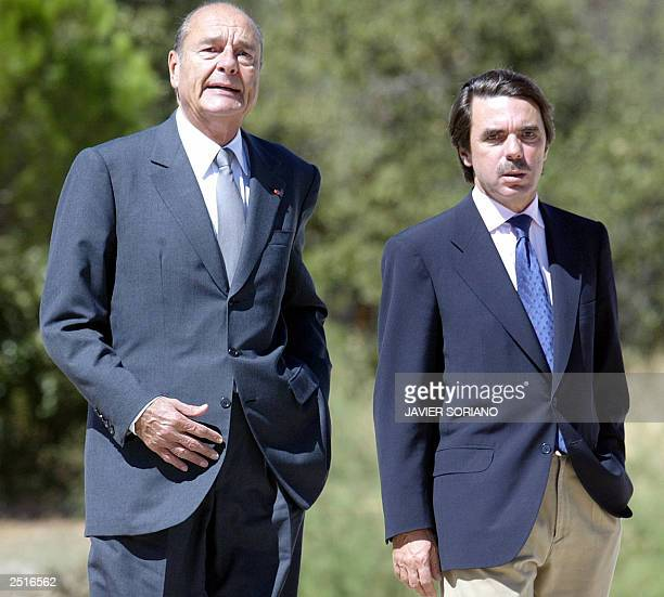 Spanish Prime Minister Jose Maria Aznar walks with French President Jacques Chirac before a meeting at Quintos de Mora in Toledo south of Madrid 11...