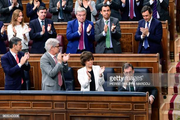 TOPSHOT Spanish Prime Minister Mariano Rajoy acknowledges applause from Popular Party's members of parliament during a debate on a noconfidence...