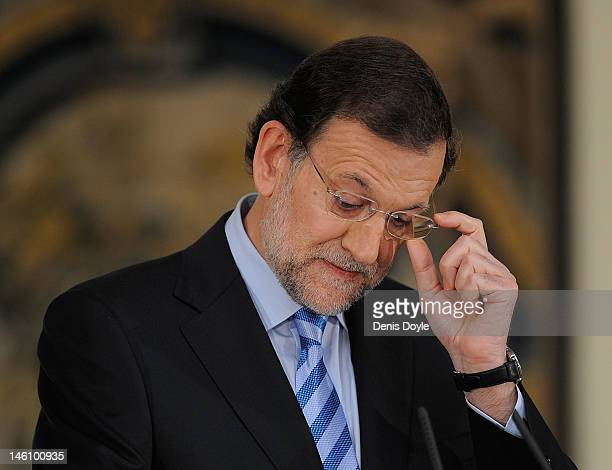 Spanish Prime Minister Mariano Rajoy addresses the media at the Moncloa palace after requesting financial support from the European Union yesterday...