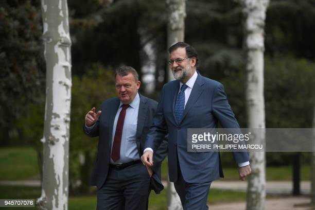 Spanish Prime Minister Mariano Rajoy and Danish Prime Minister Lars Lokke Rasmussen walk in the garden of the Moncloa Palace in Madrid on April 13,...