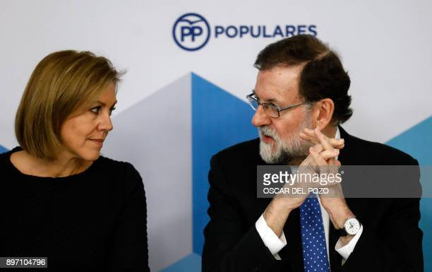 Spanish Prime Minister Mariano Rajoy and her Spanish Minister of Defence Maria Doroles de Cospedal attend a Popular Party meeting of the national...