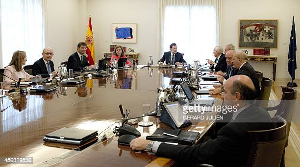 Spanish Prime Minister Mariano Rajoy and his ministers attend an extraordinary cabinet meeting on the Catalonia independence vote on September 29...