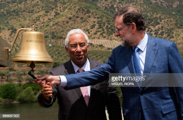 """Spanish Prime Minister Mariano Rajoy and his Portuguese counterpart Antonio Costa both ring the bell of the """"MS Douro Elegance"""" ship on the first day..."""
