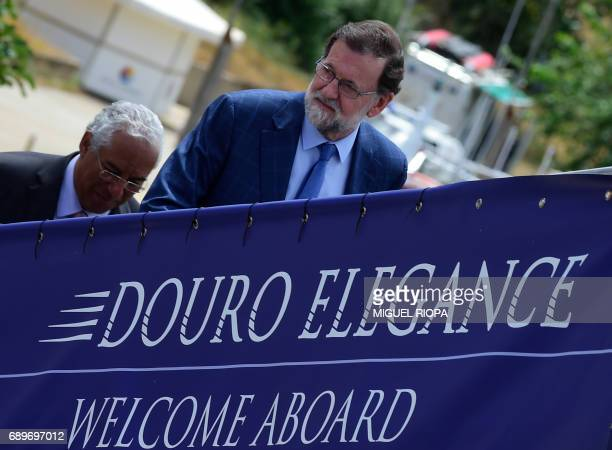 """Spanish Prime Minister Mariano Rajoy and his Portuguese counterpart Antonio Costa arrive onboard the """"MS Douro Elegance"""" ship on the first day of the..."""