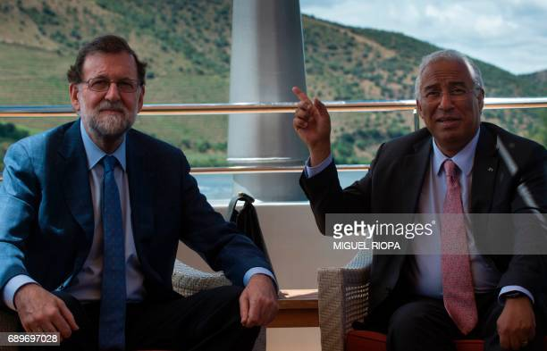 """Spanish Prime Minister Mariano Rajoy and his Portuguese counterpart Antonio Costa pose as they meet on the """"MS Douro Elegance"""" ship on the first day..."""