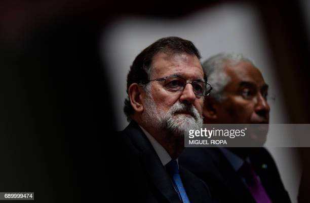 Spanish Prime Minister Mariano Rajoy and his Portuguese counterpart Antonio Costa sit during a meeting with Portuguese and Spanish entrepreneurs...