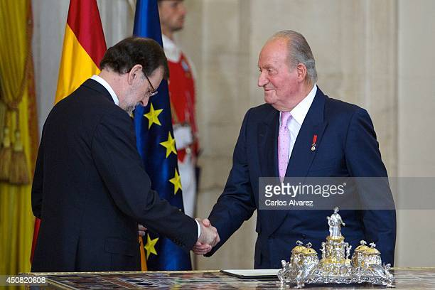 Spanish prime minister Mariano Rajoy and King Juan Carlos of Spain attend the official abdication ceremony at the Royal Palace on June 18 2014 in...