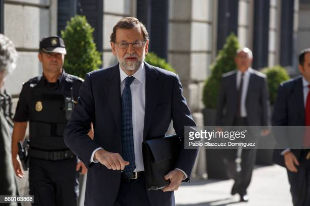 Spanish Prime Minister Mariano Rajoy arrives at the Spanish Parliament following a crisis meeting over the Catalonian independence vote on October 11...