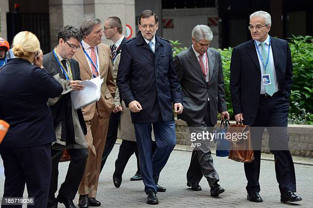 Spanish Prime Minister Mariano Rajoy arrives on foot on October 24 2013 to attend a European Council meeting at the EU headquarters in Brussels...
