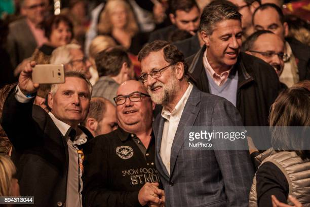 Spanish Prime Minister Mariano Rajoy arrives to attend a campaign meeting in Salou on December 17 2017 Catalonia heads into the final stretch before...