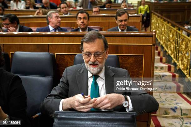 Spanish Prime Minister Mariano Rajoy arrives to his sit during a debate on a noconfidence motion at the Lower House of the Spanish Parliament on May...