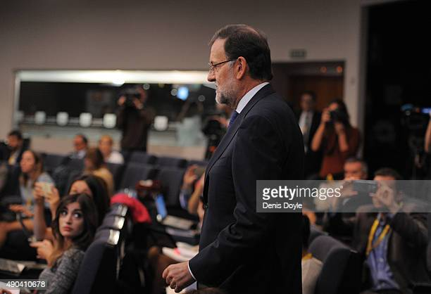 Spanish Prime Minister Mariano Rajoy arrives to make a brief statement to the press at the Moncloa palace on September 28 2015 in Madrid Spain...