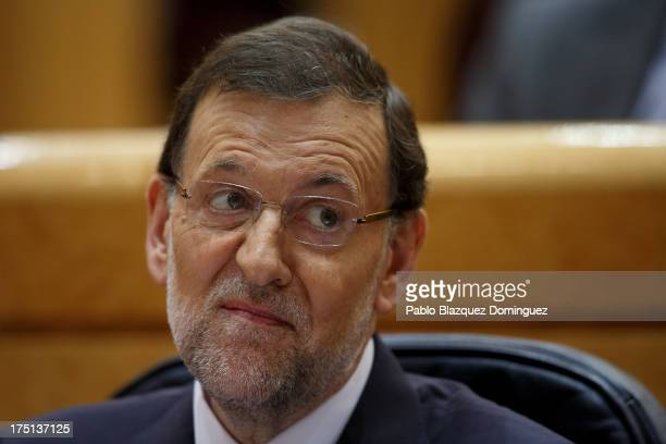 Spanish Prime Minister Mariano Rajoy attends a parliament session to speak over allegations on corruption scandals on August 1 2013 in Madrid Spain...