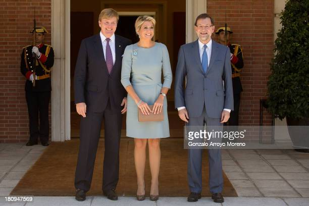 Spanish Prime Minister Mariano Rajoy Brey poses alongside Queen Maxima of the Netherlands and King Willem-Alexander of the Netherlands at La Moncloa...