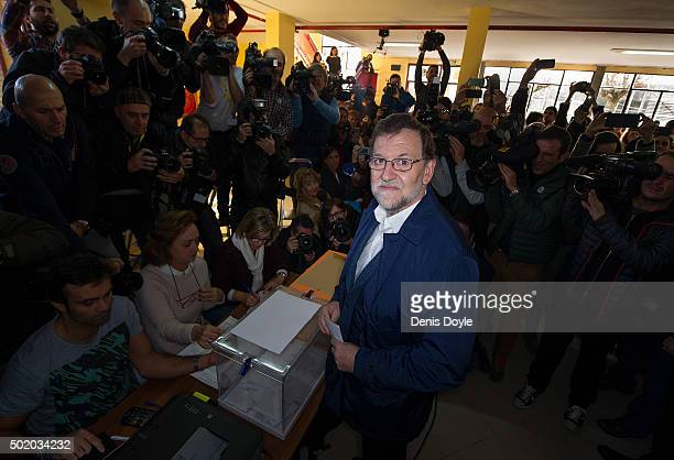 Spanish Prime Minister Mariano Rajoy casts his vote during General Elections at a polling station on December 20 2015 in Madrid Spain Spaniards went...