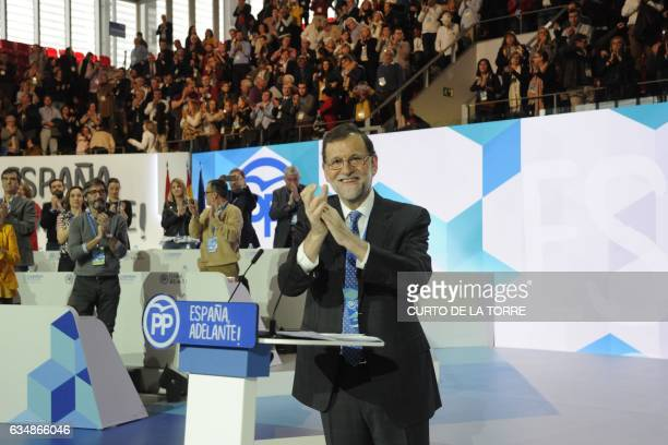 Spanish Prime Minister Mariano Rajoy claps during the closing of the the XVIII Popular Party three day congress in Madrid on February 12 2017 that...