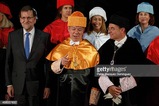 Spanish Prime Minister Mariano Rajoy Colombia's President Juan Manuel Santos University rector Eduardo Nolla Blanco pose for a picture during...