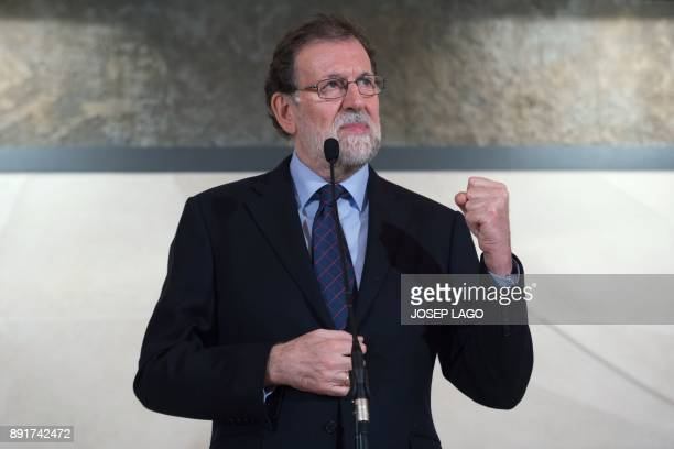 Spanish Prime Minister Mariano Rajoy delivers a speech during a visit to the Freixenet winery in Barcelona on December 13 2017 / AFP PHOTO / Josep...
