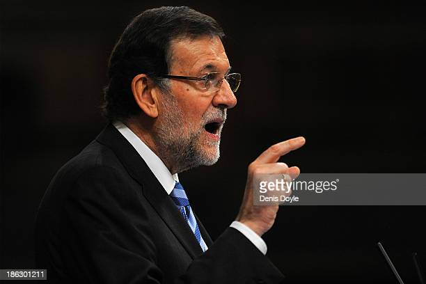 Spanish Prime Minister Mariano Rajoy gestures as he addresses the parliament about alleged mass US eavesdropping on millions of Spanish citizens'...