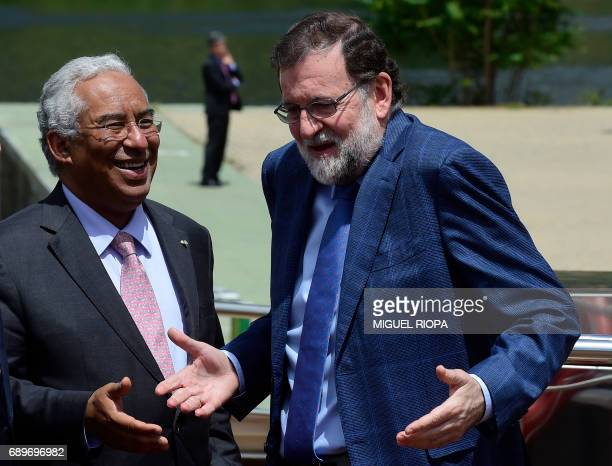 """Spanish Prime Minister Mariano Rajoy gestures as he chats with his Portuguese counterpart Antonio Costa on the """"MS Douro Elegance"""" ship on the first..."""