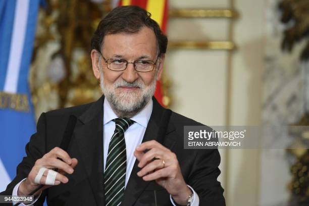 Spanish Prime Minister Mariano Rajoy gestures during a joint press conference with Argentinian President Mauricio Macri at the Casa Rosada...