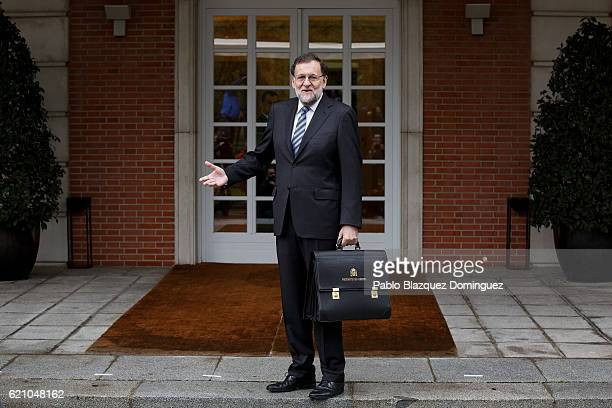 Spanish Prime Minister Mariano Rajoy gestures while posing for photographers as he arrives to the presentation of his new Government at Moncloa...