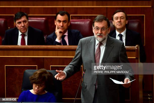 Spanish Prime Minister Mariano Rajoy giveds a speech during a session at the Lower House of Parliament in Madrid on May 30 two days before the...