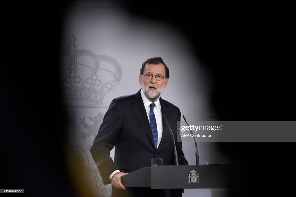 Spanish Prime Minister Mariano Rajoy gives a press conference after a crisis cabinet meeting at the Moncloa Palace on October 21, 2017 in Madrid. Spain's government said that it will move to suspend Catalonia's separatist government and call fresh elections in the region in a bid to stop its leaders from declaring independence. Speaking after an emergency cabinet meeting, Rajoy said his government had no choice after Catalonia's separatist government acted in a way that was 'unilateral, contrary to the law and seeking confrontation' in holding a banned independence referendum. BOUYS