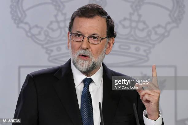 Spanish Prime Minister Mariano Rajoy gives a press conference after a crisis cabinet meeting at the Moncloa Palace on October 21 2017 in Madrid...