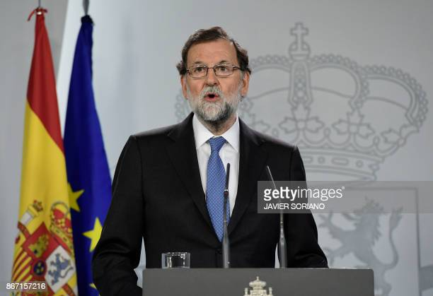 TOPSHOT Spanish Prime Minister Mariano Rajoy gives a press conference after a cabinet meeting at La Moncloa Palace in Madrid on October 27 2017...