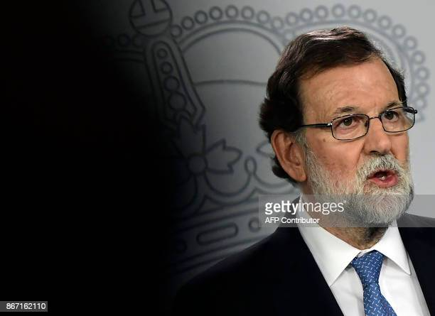 Spanish Prime Minister Mariano Rajoy gives a press conference after a cabinet meeting at La Moncloa Palace in Madrid on October 27 2017 Spanish Prime...