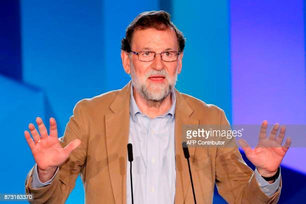 Spanish Prime Minister Mariano Rajoy gives a speech during a meeting to support his Popular Party candidate in next month's vote in Barcelona on...