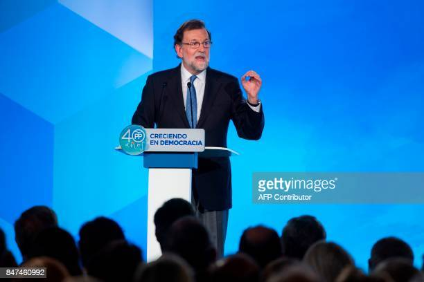 Spanish Prime Minister Mariano Rajoy gives a speech during a regional Popular Party meeting in Barcelona on September 15 2017 Spain's central...