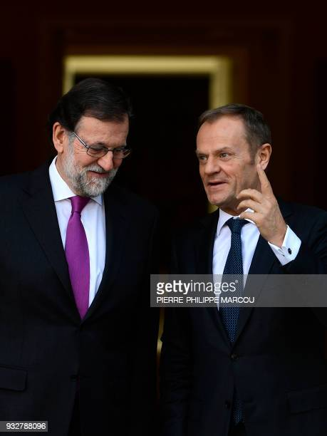Spanish Prime Minister Mariano Rajoy listens to European Council president Donald Tusk upon his arrival for a meeting at the Moncloa Palace in Madrid...