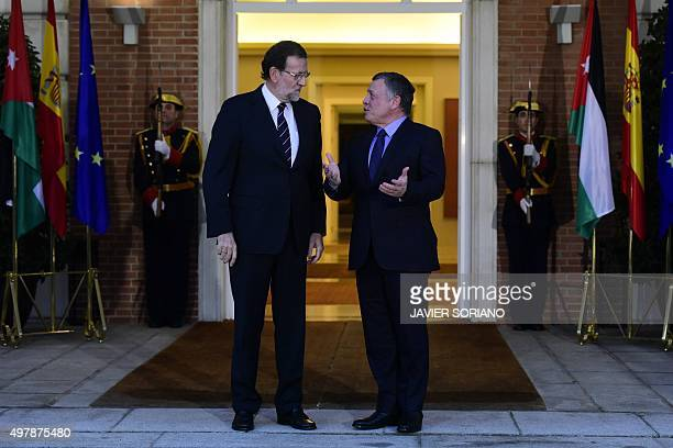 Spanish Prime Minister Mariano Rajoy listens to King Abdallah II of Jordan before a meeting at La Moncloa Palace in Madrid on November 19 2015 AFP...