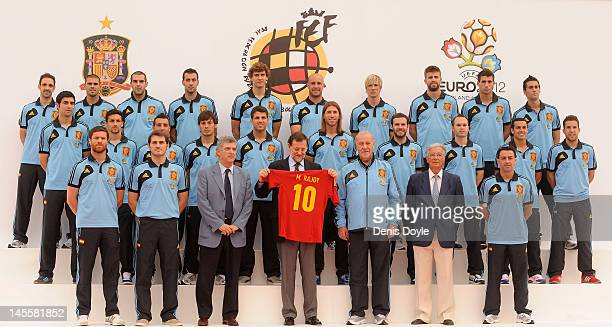 Spanish Prime Minister Mariano Rajoy looks at a Spanish team jersey he was given beside Spanish head coach Vicente del Bosque captain Iker Casillas...