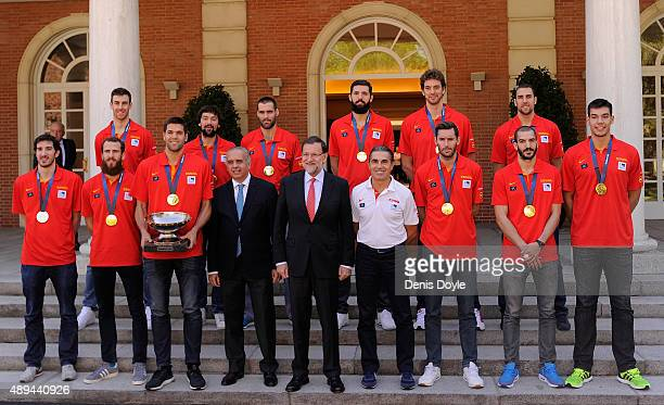Spanish Prime Minister Mariano Rajoy poses for a team photograph with Spain coach Sergio Scariolo and players at the Moncloa palace after winning the...
