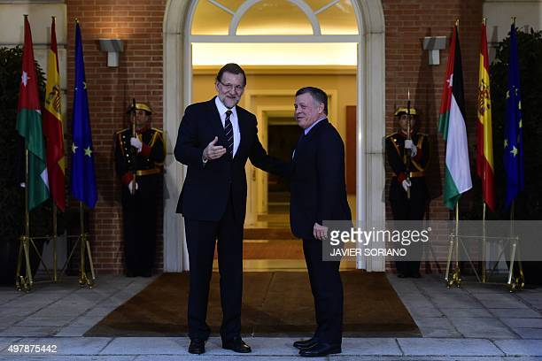 Spanish Prime Minister Mariano Rajoy poses with King Abdallah II of Jordan before a meeting at La Moncloa Palace in Madrid on November 19 2015 AFP...