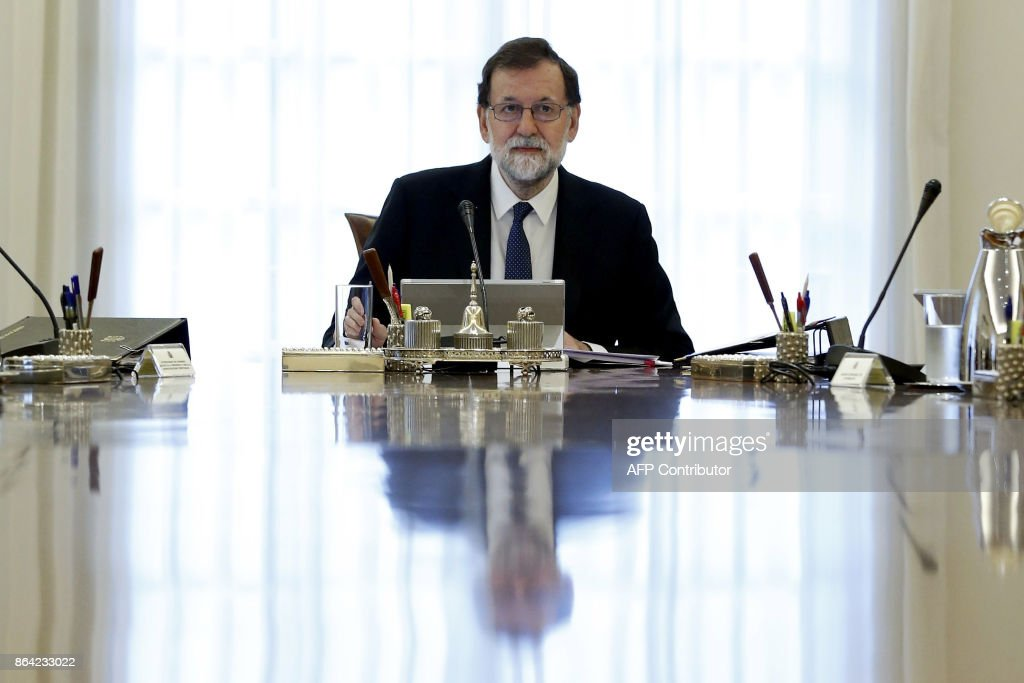 Spanish Prime Minister Mariano Rajoy presides a crisis cabinet meeting at the Moncloa Palace on October 21, 2017 in Madrid. Spain's government kicked off a crisis cabinet meeting as it prepares to seize powers from Catalonia's separatist government in a bid to stop the northeastern region's independence drive. PHOTO / POOL / Juan Carlos Hidalgo