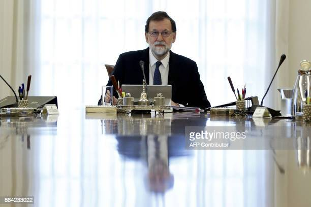 Spanish Prime Minister Mariano Rajoy presides a crisis cabinet meeting at the Moncloa Palace on October 21, 2017 in Madrid. Spain's government kicked...