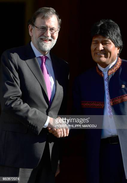 Spanish Prime Minister Mariano Rajoy shakes hands with Bolivian President Evo Morales during a meeting at the Moncloa Palace in Madrid on March 16,...
