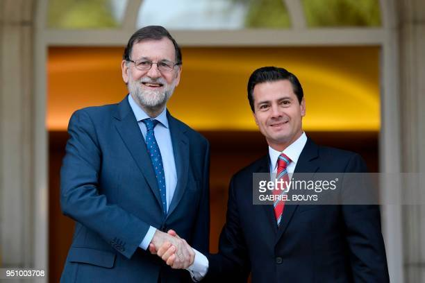 Spanish Prime Minister Mariano Rajoy shakes hands with Mexican President Enrique Pena Nieto upon his arrival for a meeting at La Moncloa in Madrid on...